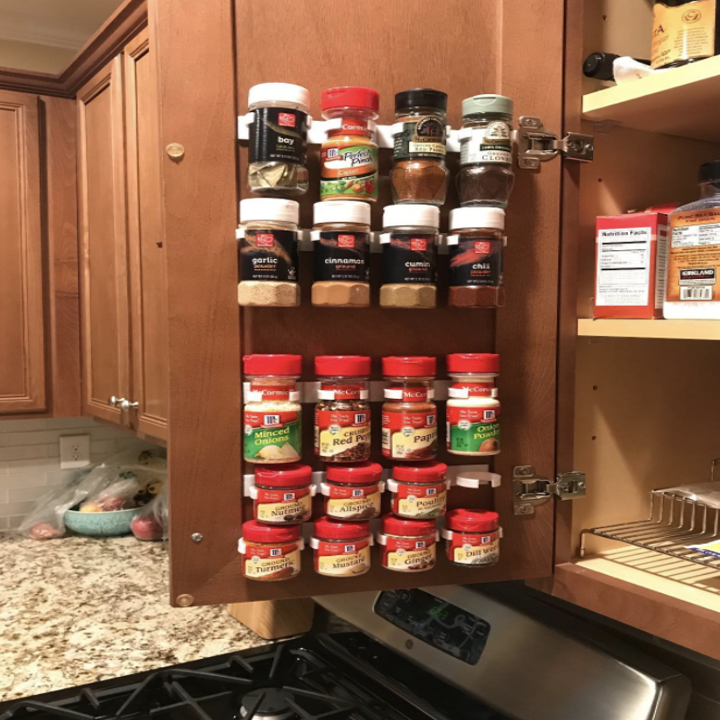 reviewer image of spice grippers in cupboard