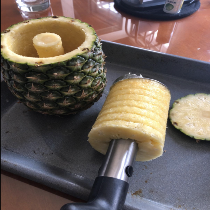 reviewer using pineapple corer