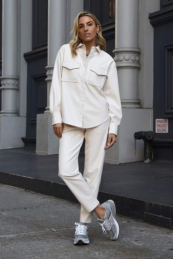 a model wearing the jacket in ivory