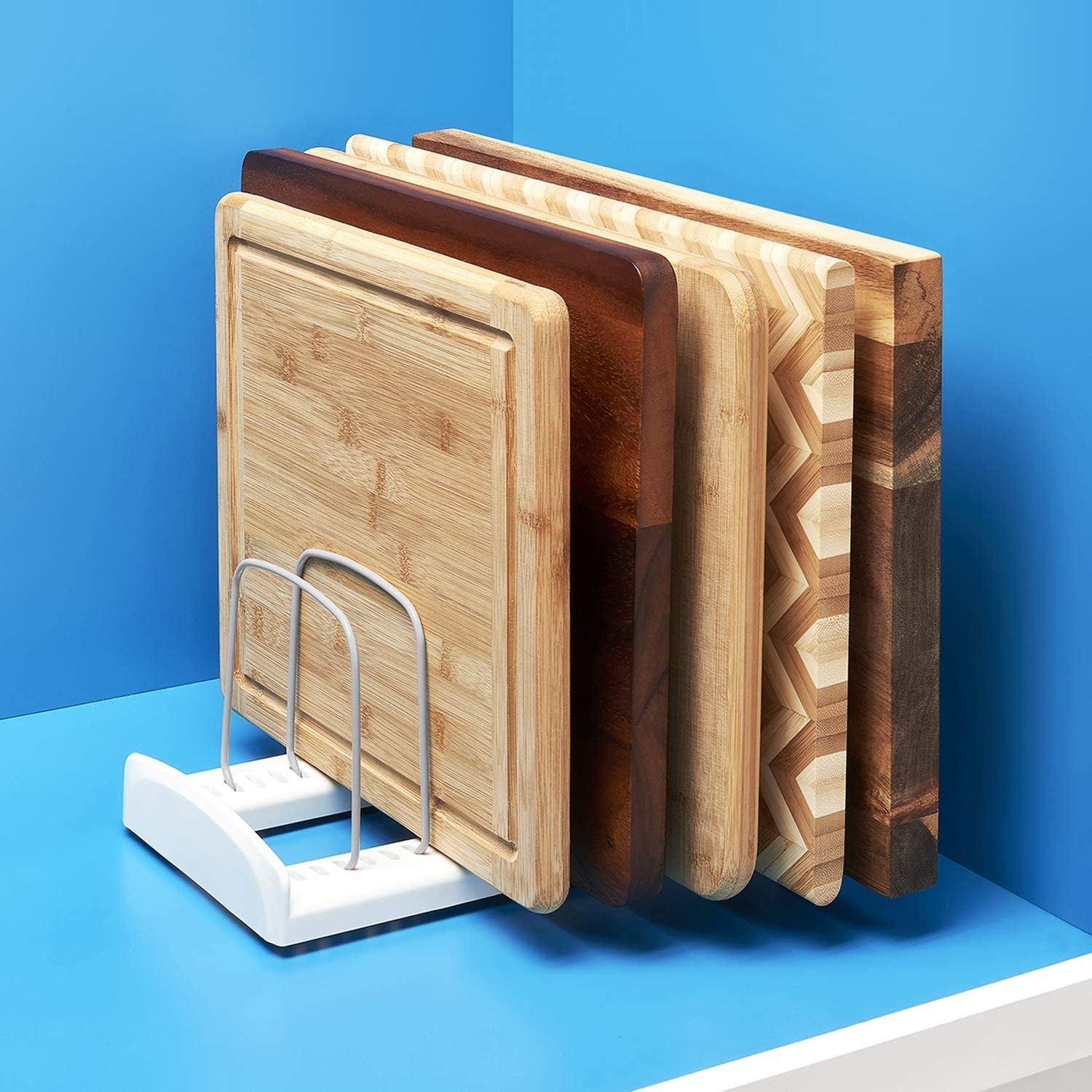 five cutting boards in the slotted organizer