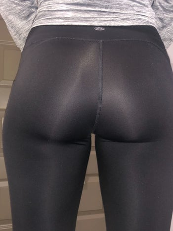 a reviewer showing the back of the leggings