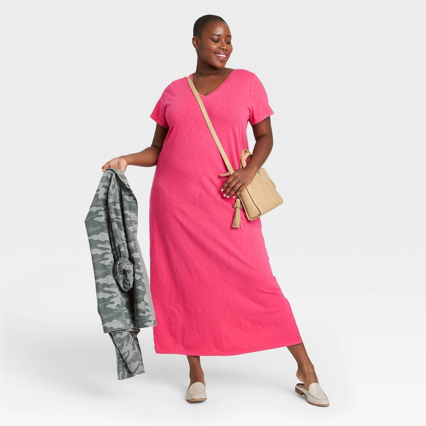 a model in a pink maxi dress