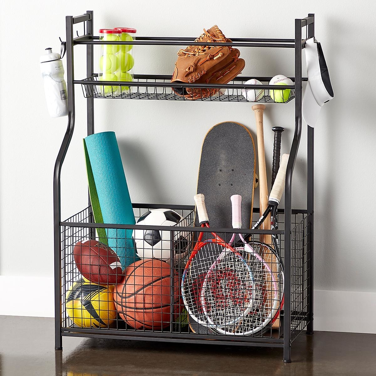 the heavy duty sports storage rack with balls, rackets, mitts and more in its upper shelf and lower basket