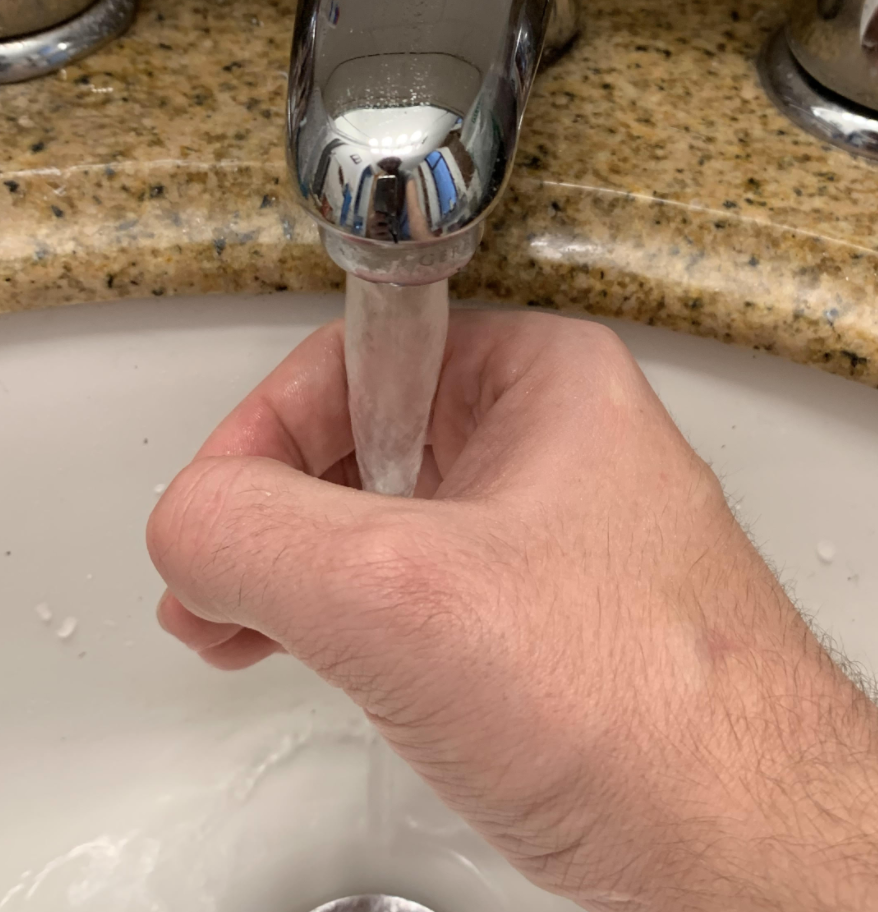 water running through the middle of a hand