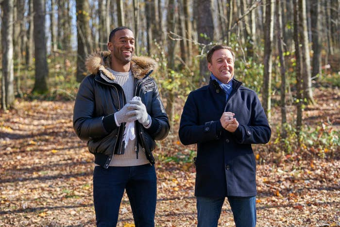 Matt and Chris standing in the woods while filming the Bachelor