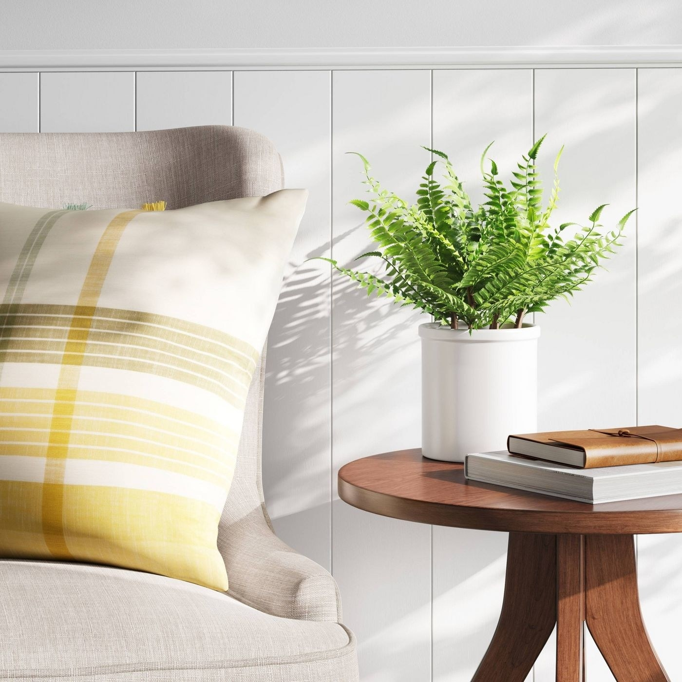 small fake fern plant sitting on a side table