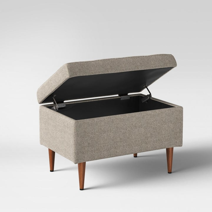 grey storage ottoman with the lid up