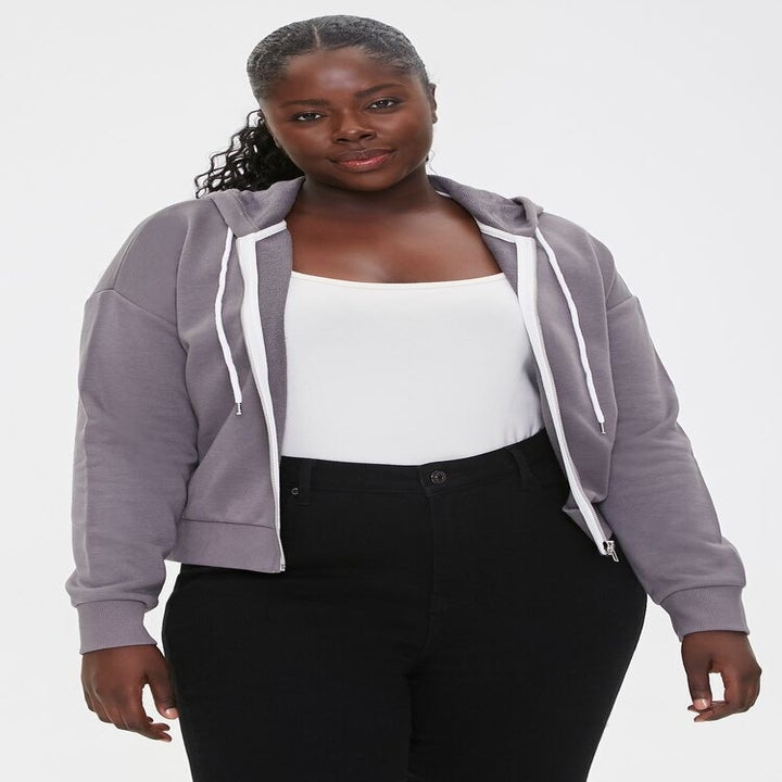 model wearing the zip-up in gray