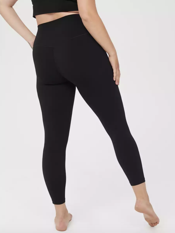 a model showing the back of the leggings