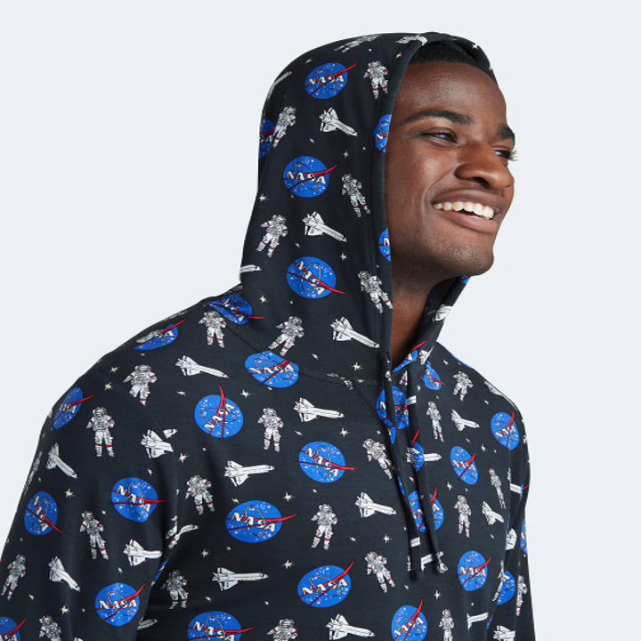 model wearing the hoodie in black with a blue NASA print on it