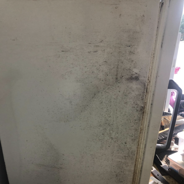 A reviewer's dirty white fridge before using the cleaning kit