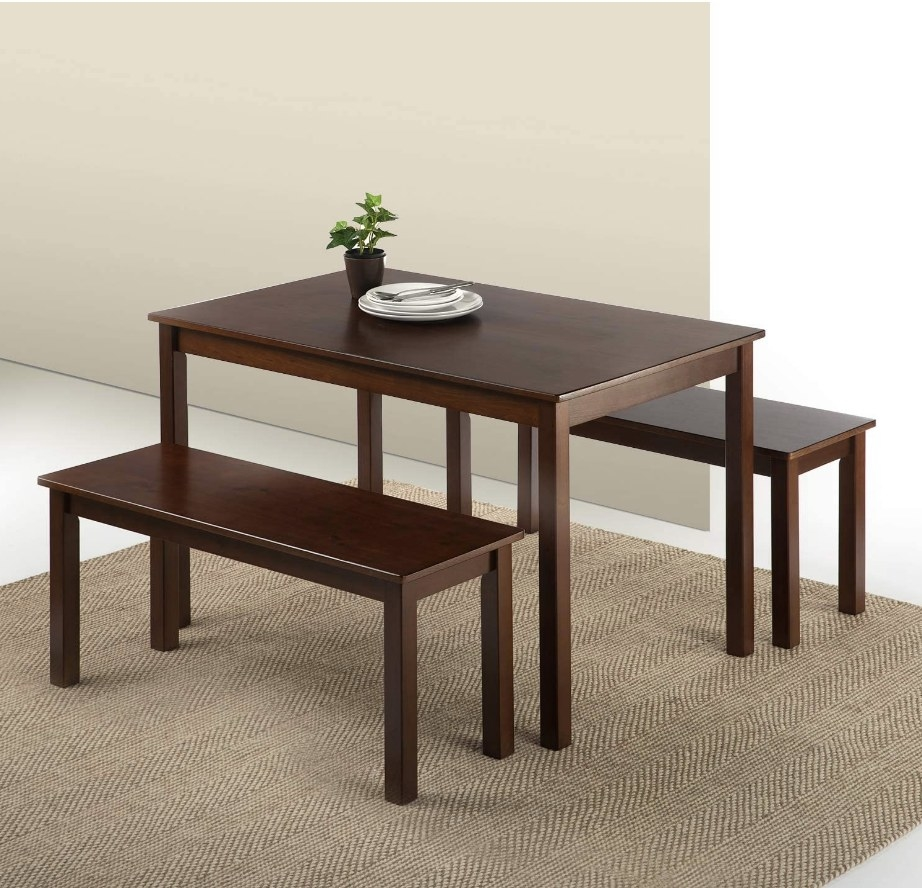 Wooden dining room set with table and two benches