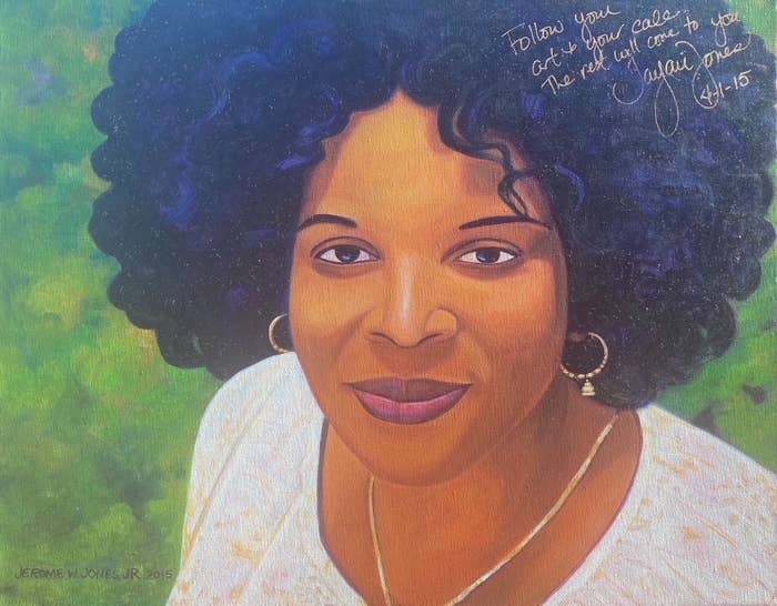 Painting of a woman grinning with earrings, a necklace, and a long-sleeve