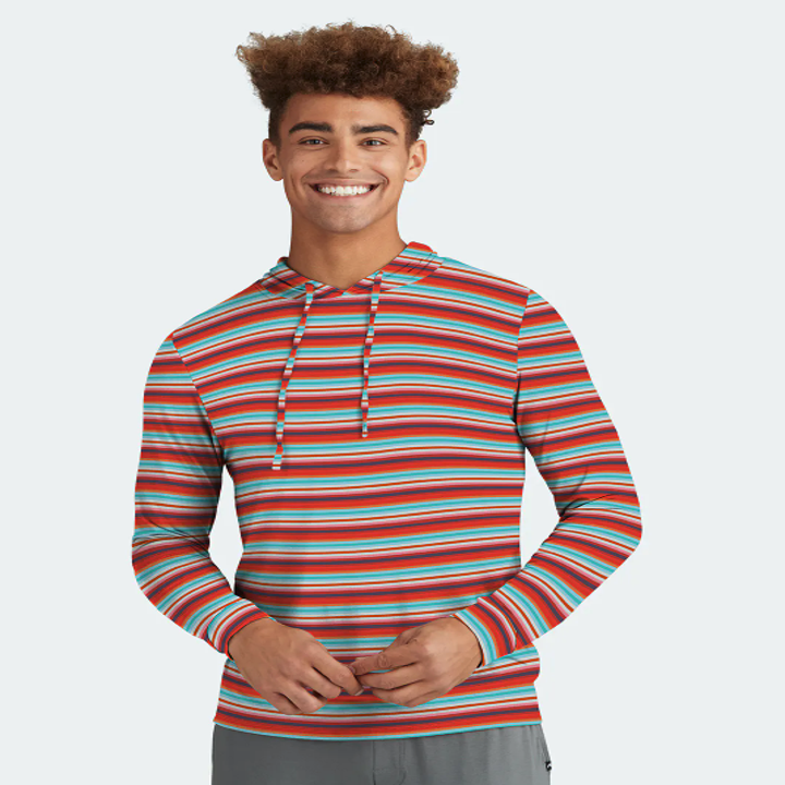 model wearing the hoodie in a teal and red striped pattern
