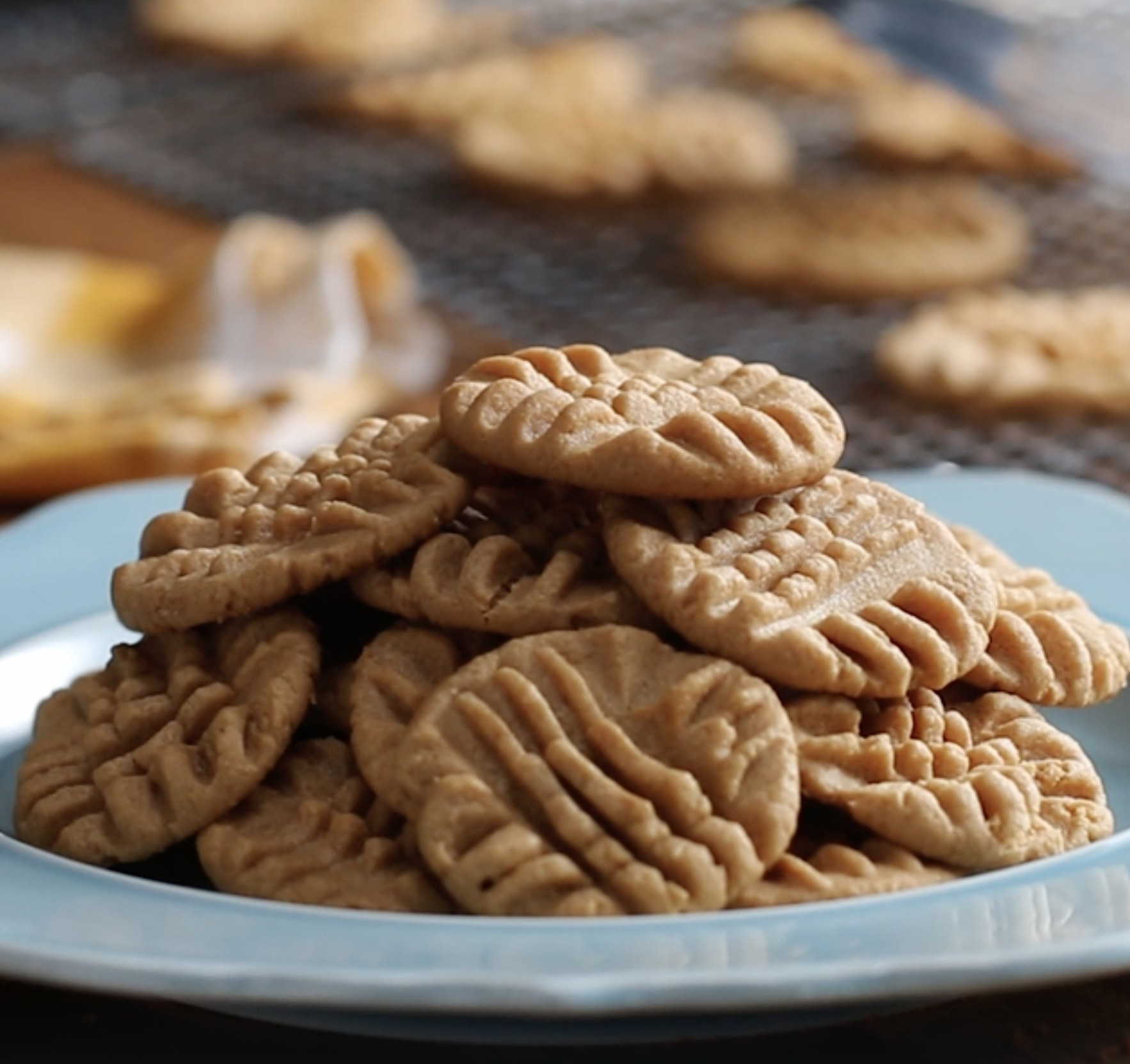 A plate with several peanut butter cookies