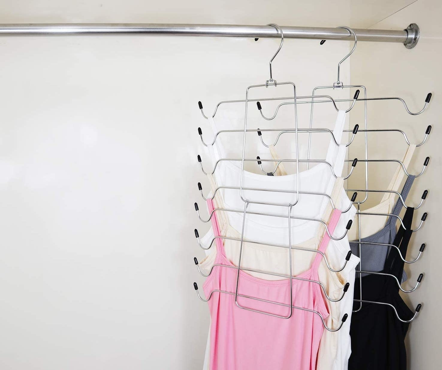Two tank top hangers placed in closet