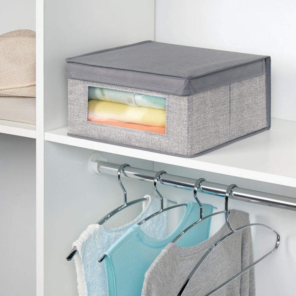 Stackable storage box placed on closet shelf
