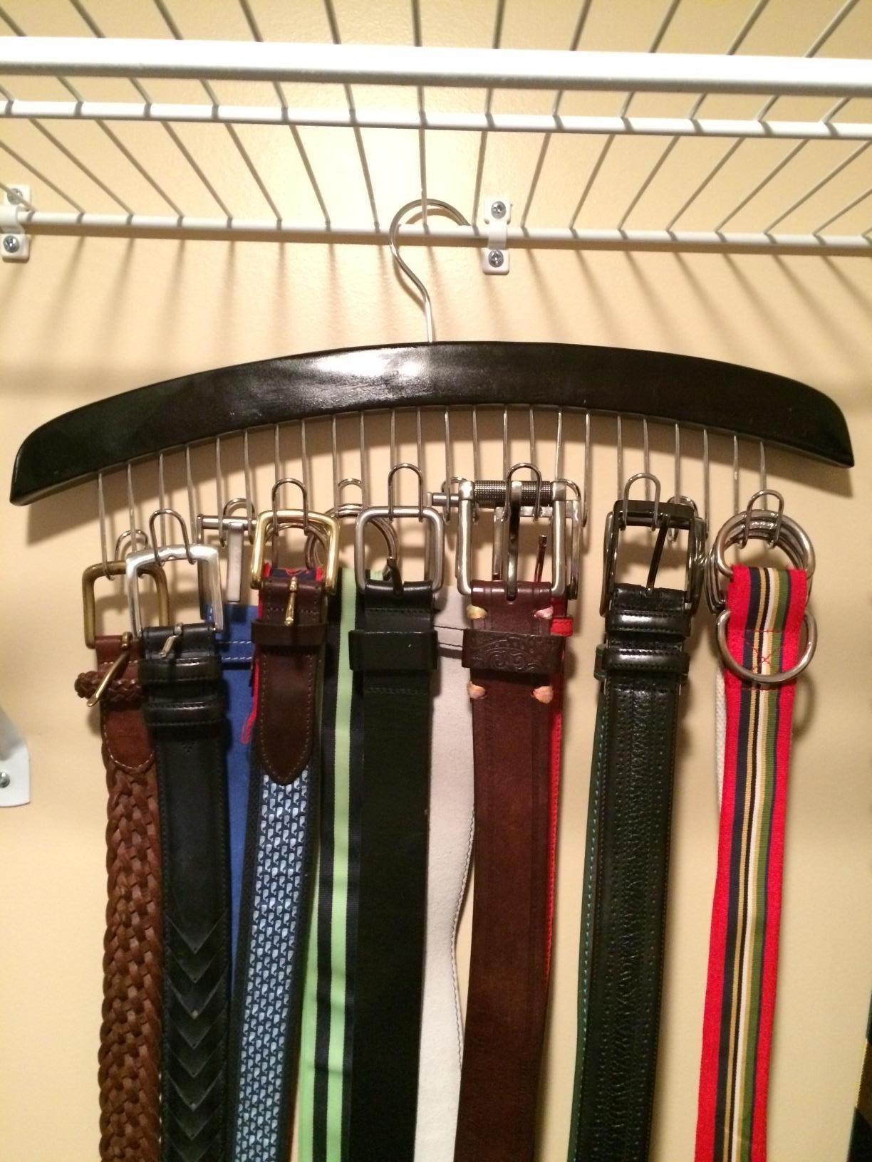 Reviewer photo of various belts hanging on belt hanger