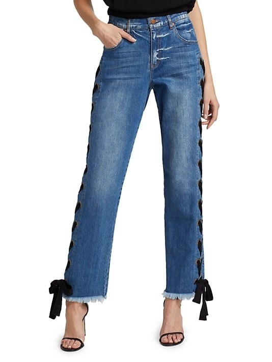 Model wearing the jeans with ribbon side design and bows on the cuffs