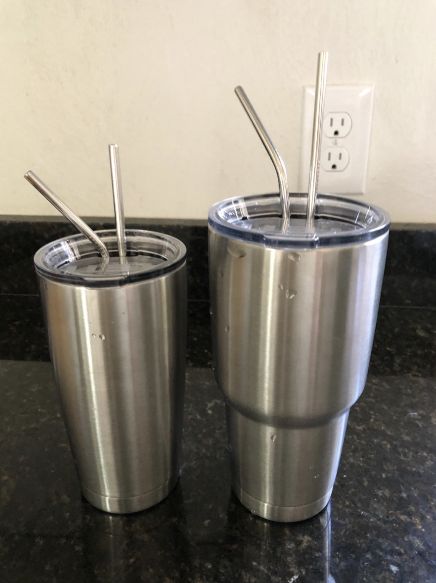 A reviewer's tumblers with the straws