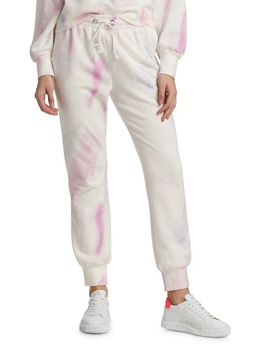 Model wearing the pink and white tie-dye joggers