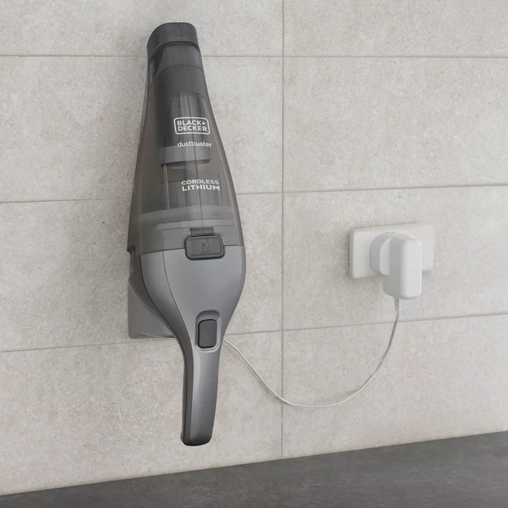 the handheld vacuum being charged