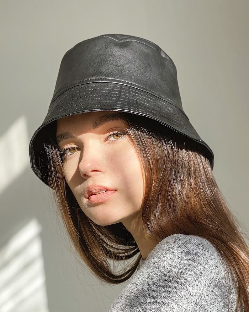 a model wearing the hat in red