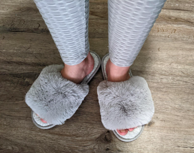 Reviewer wearing the fuzzy slippers