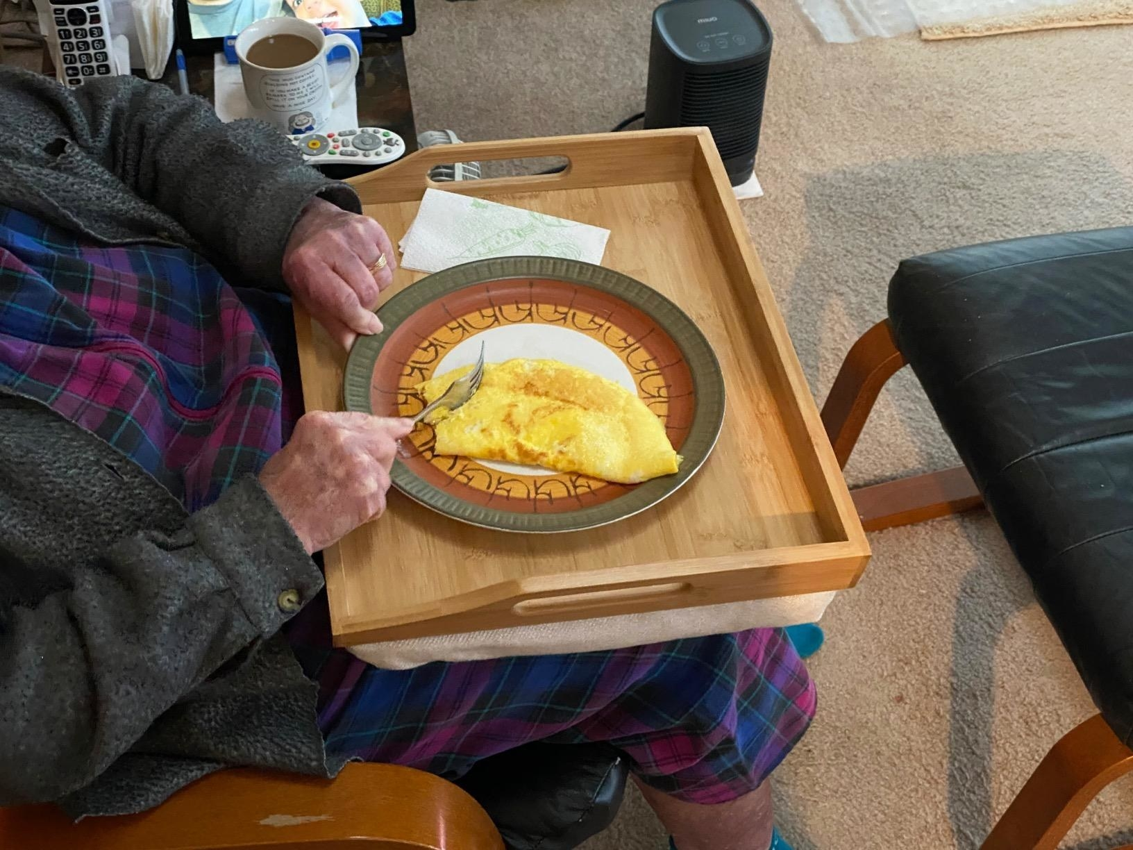 reviewer image of someone eating an omelet from the bamboo Rossie Home Lap Tray