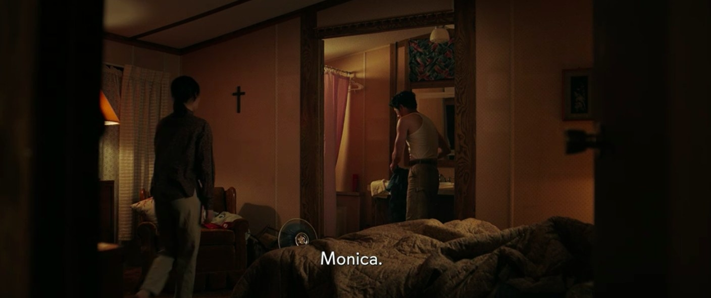 Jacob and Monica talking in their master bedroom.