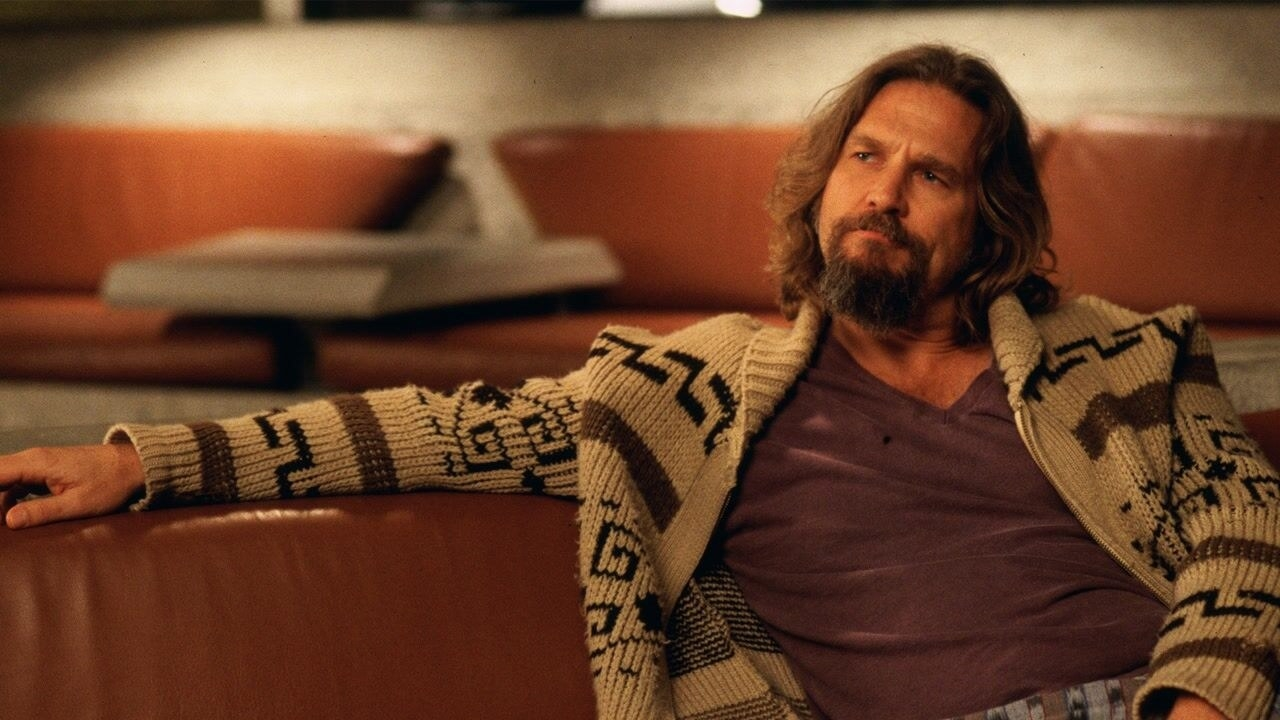 Jeff Bridges as The Dude, sitting in a bowling alley