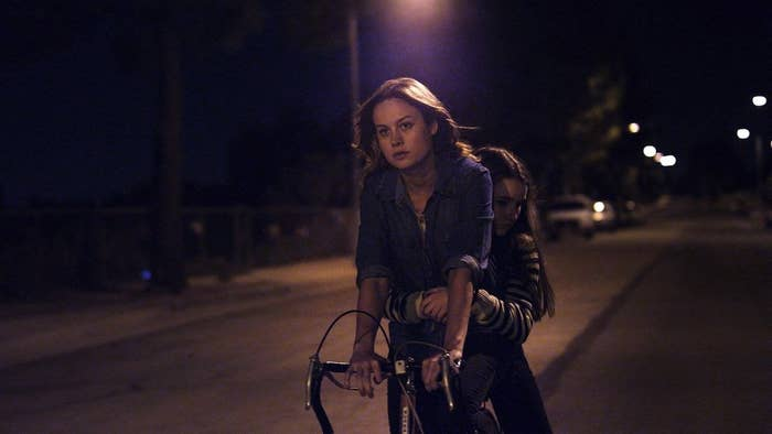 Brie Larson's character rides a bike with Kaitlyn Dever's character