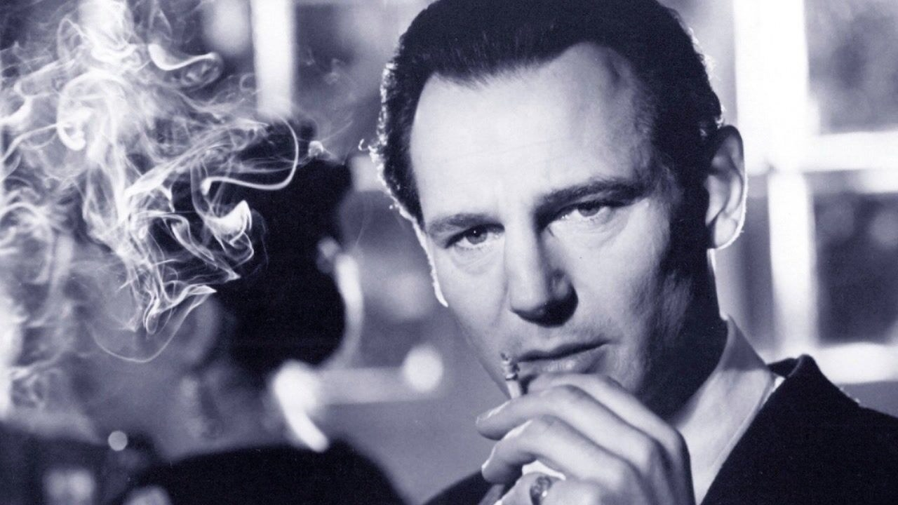 Liam Neeson's character smoking a cigarette