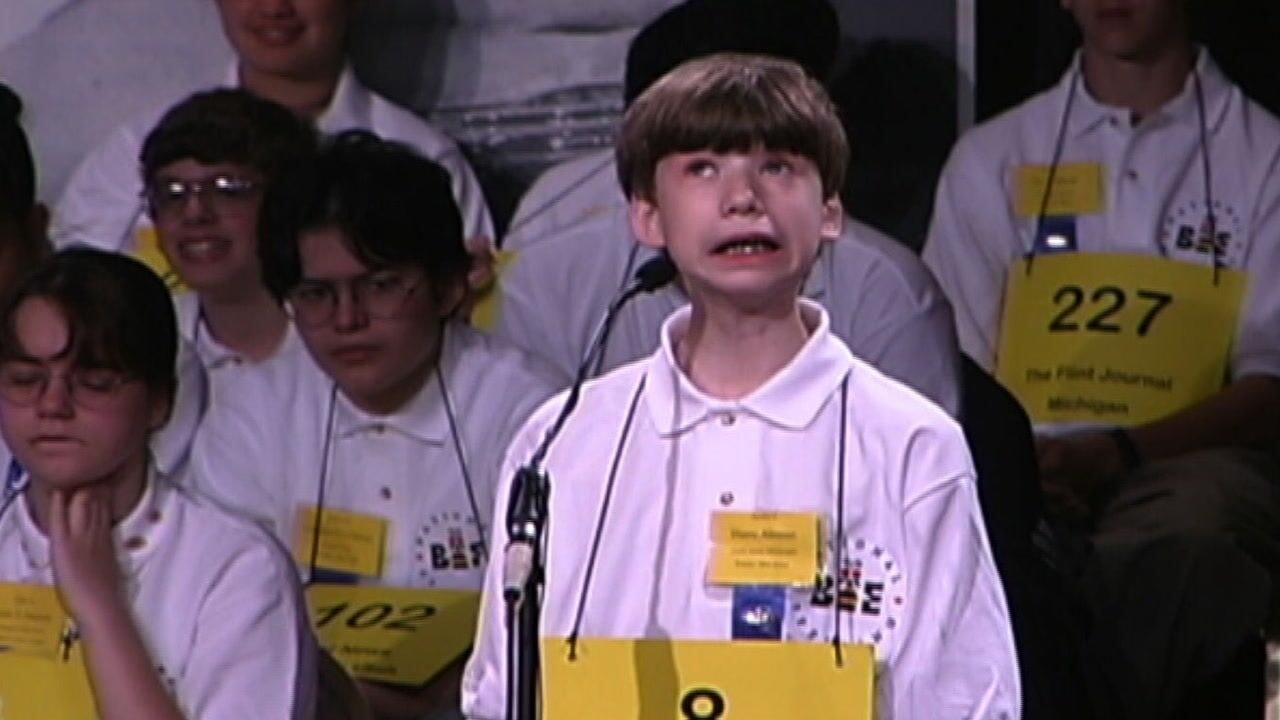 A spelling bee contestent on stage