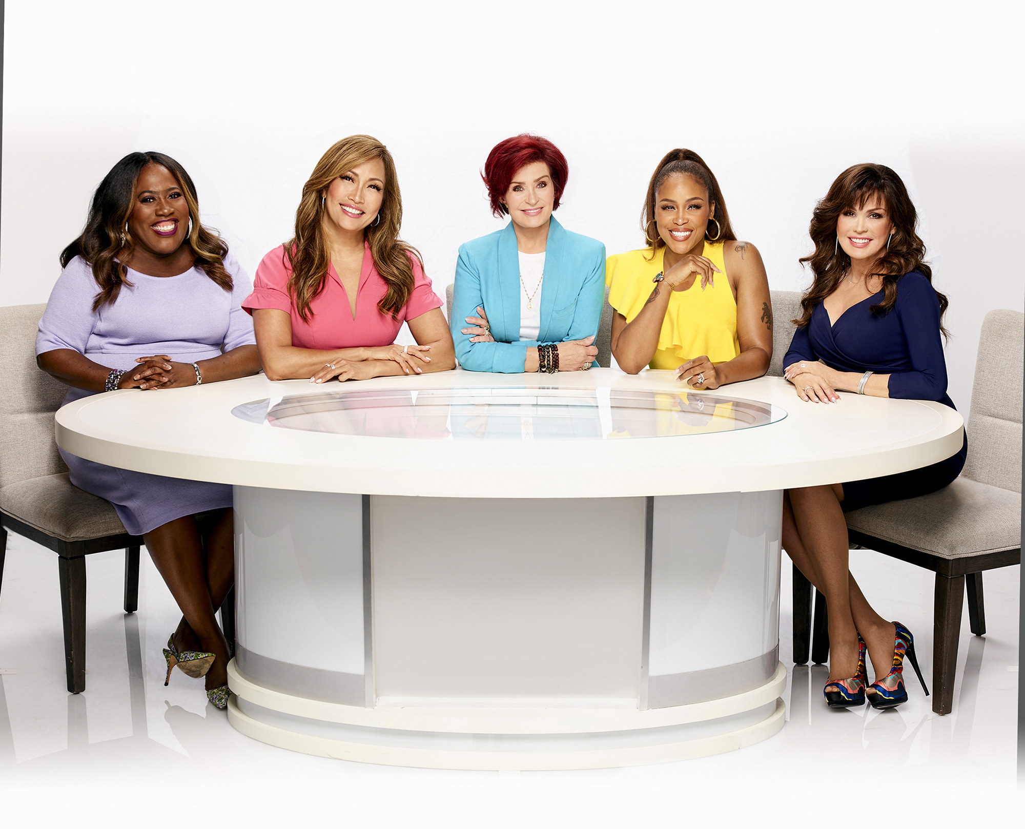 Sheryl Underwood, Carrie Ann Inaba, Sharon Osbourne, Eve Cooper, and Marie Osmond sitting around a table in a promotional photo for The Talk