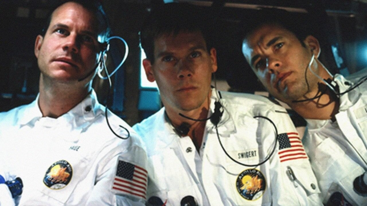 The three astronauts in their uniforms