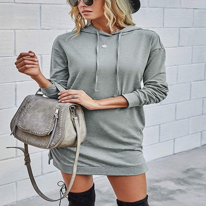 model wearing the dress in gray