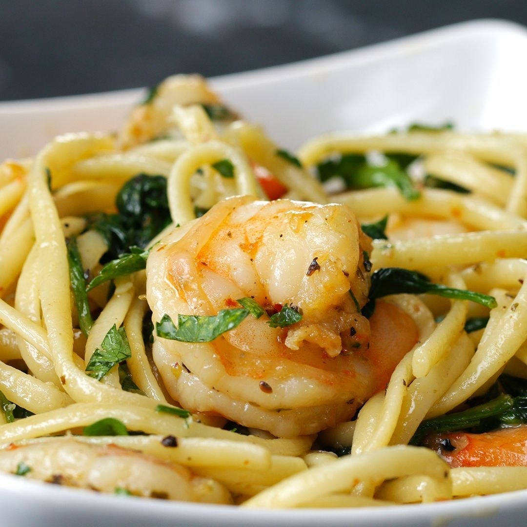 Shrimp pasta on a plate, garnished with fresh parsley