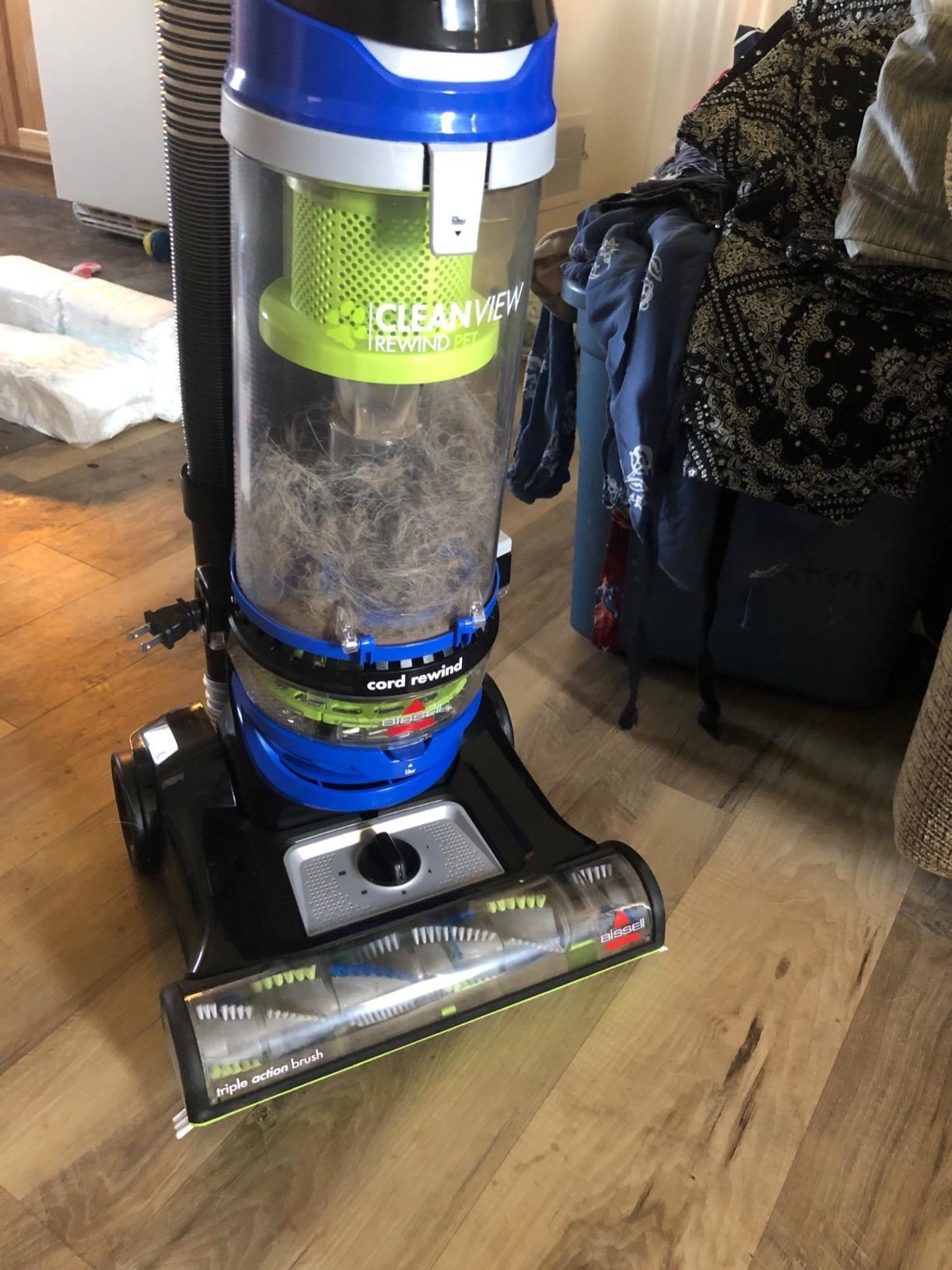 Reviewer's vacuum with triple brush roll and clear compartment