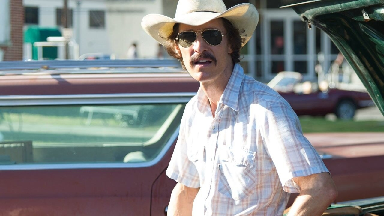 Matthew McConaughey wearing a cowboy hat and plaid shirt as Ron Woodroof