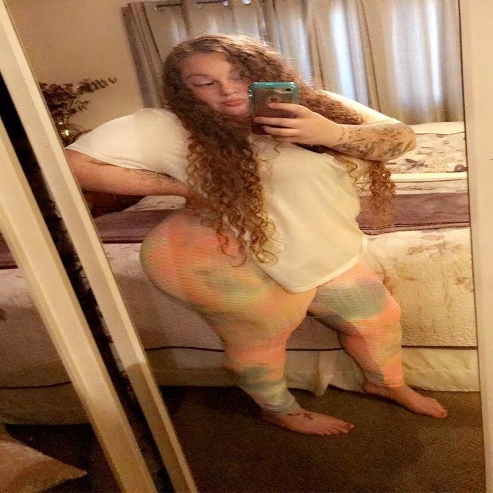 reviewer wearing the leggings in pastel tie dye