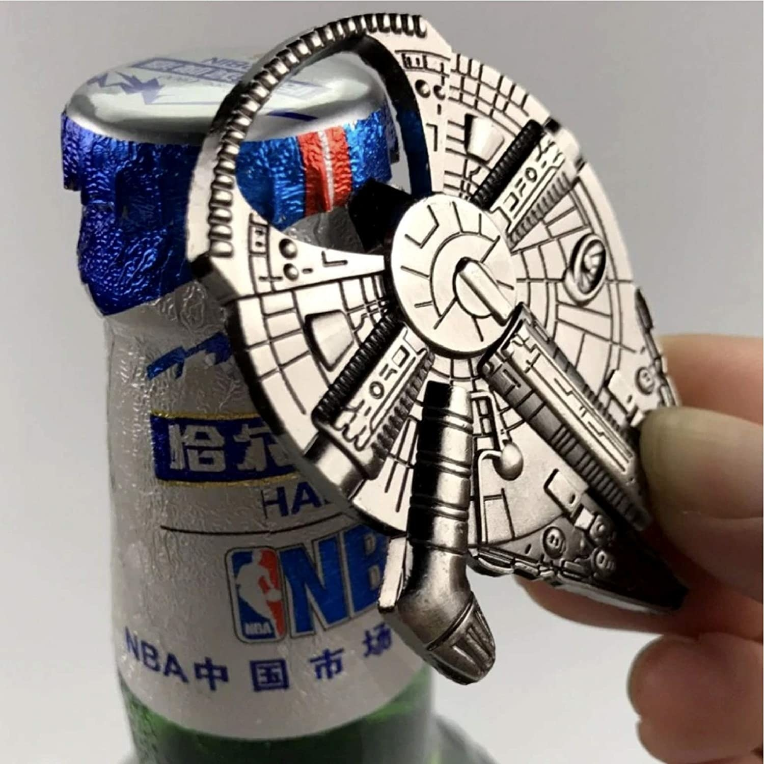 A person using the bottle opener on a beer