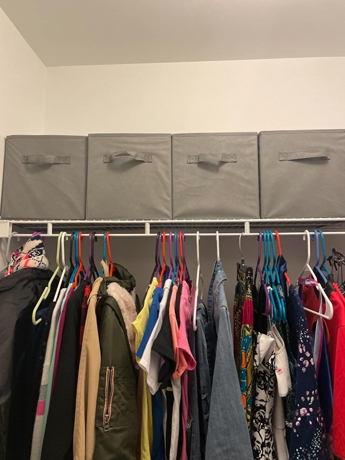 Reviewer photo of four storage cubes on closet shelf