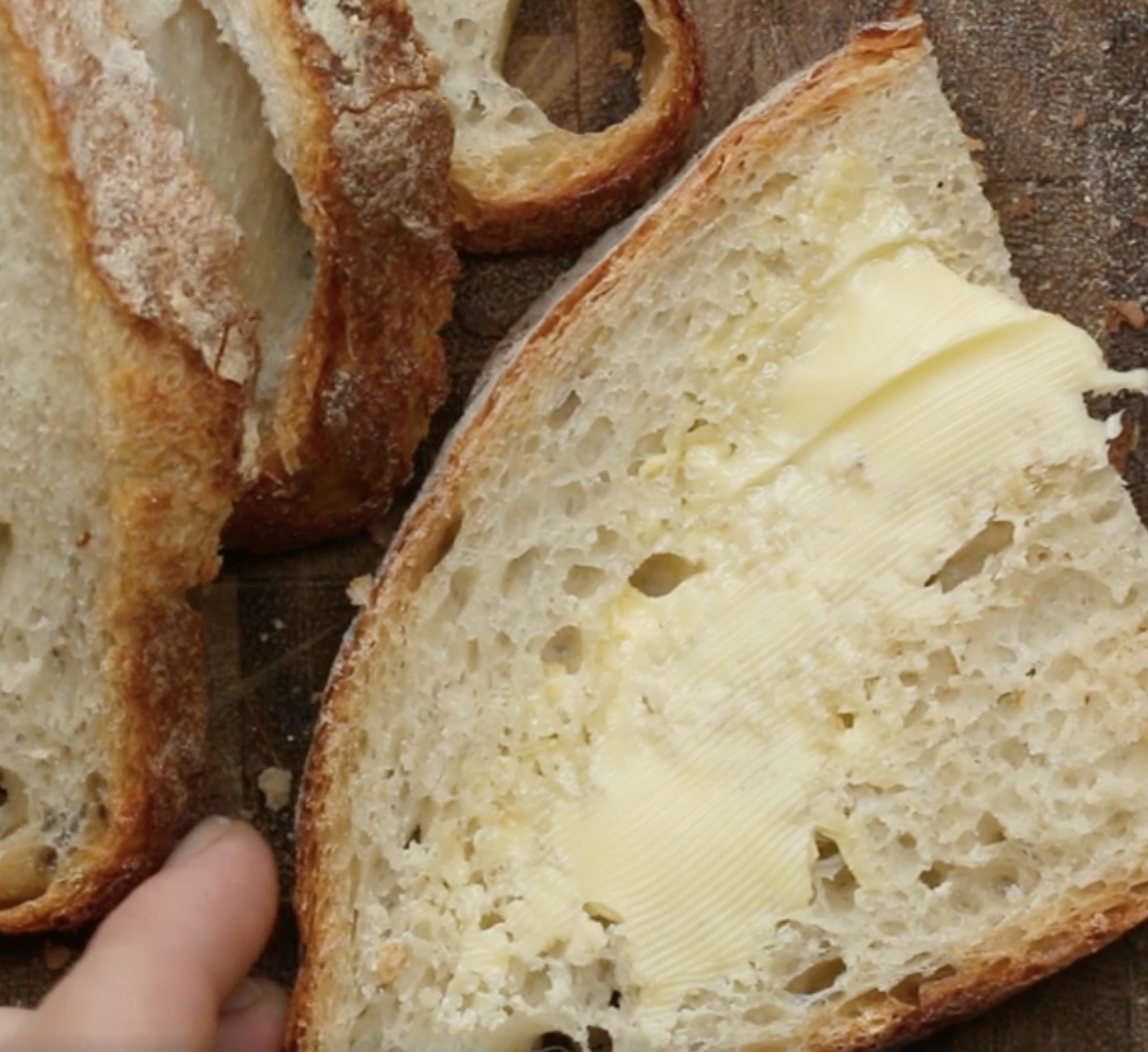 A slice of bread with butter on it