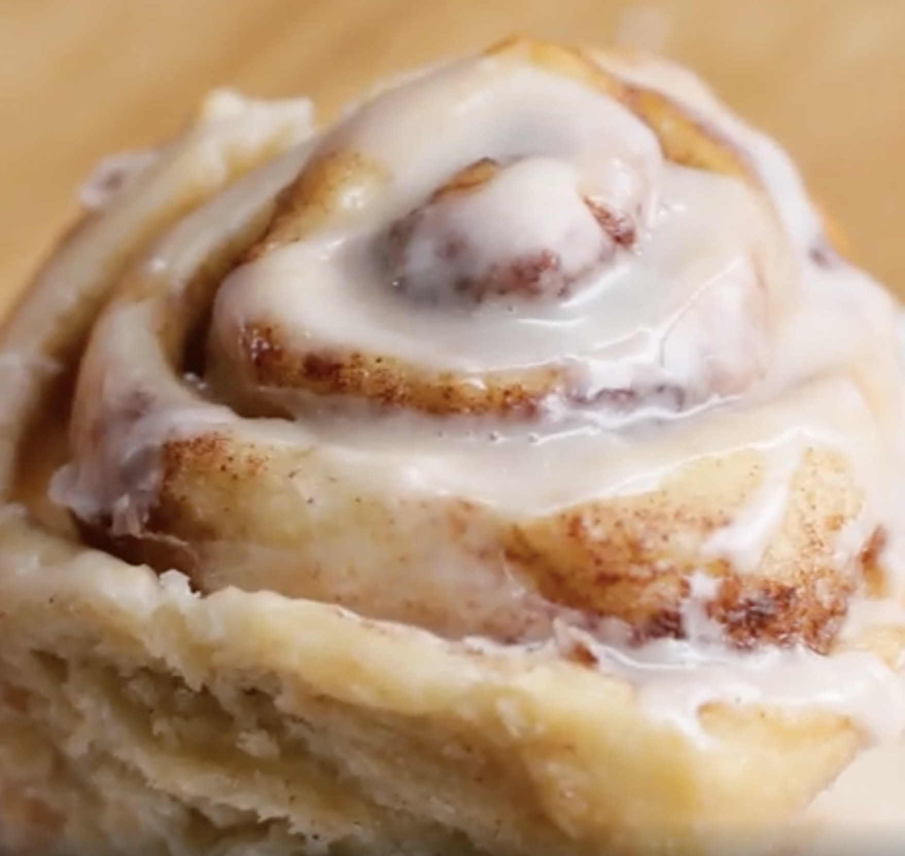 A cinnamon roll with icing
