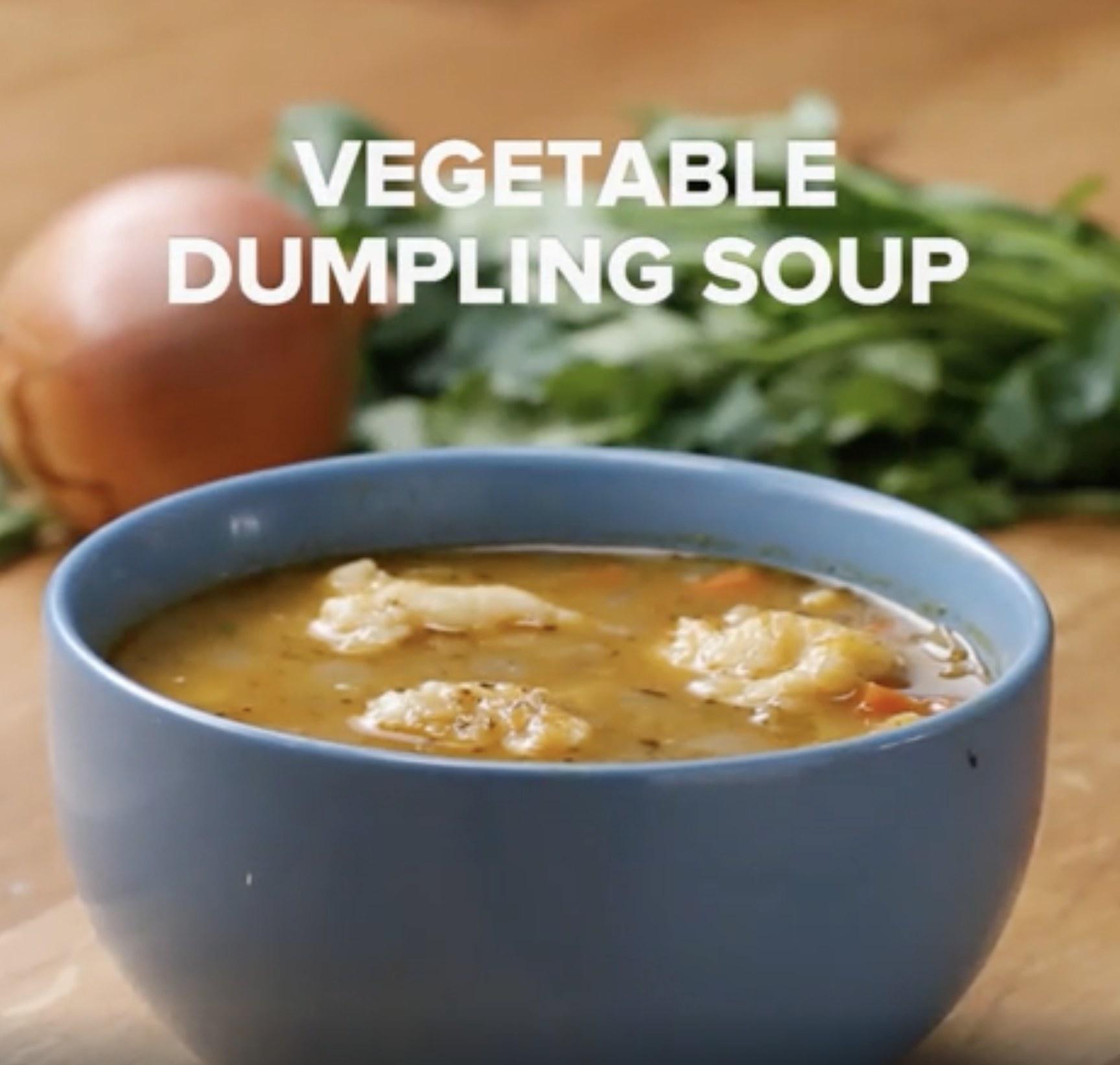 A bowl of vegetable dumpling soup