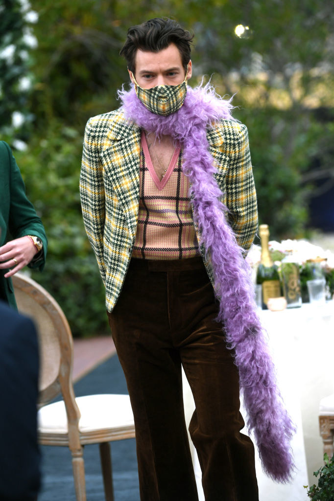 Harry Styles wears a matching plaid face mask as he attends the 63rd Annual Grammy Awards