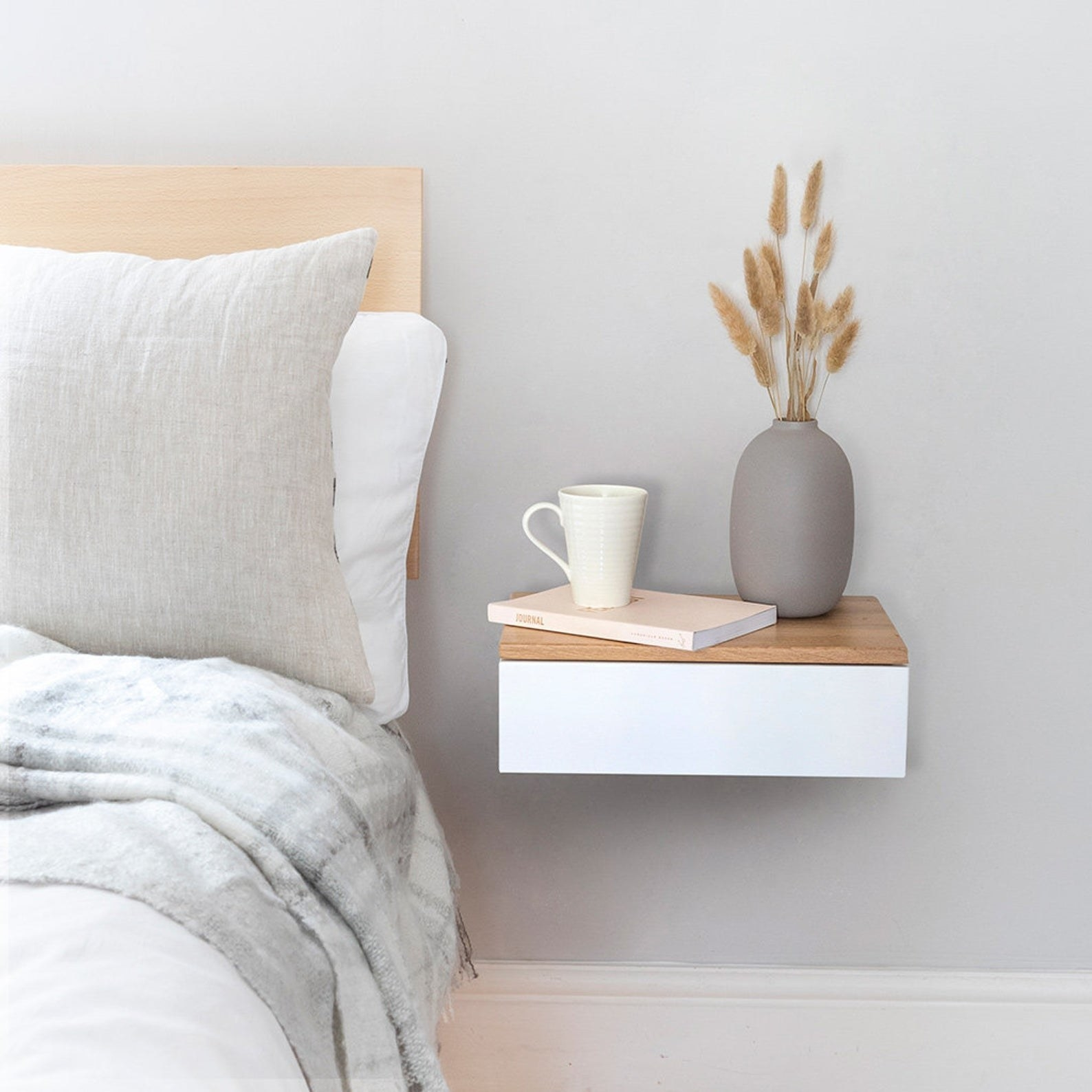 Floating bedside drawer in bedroom