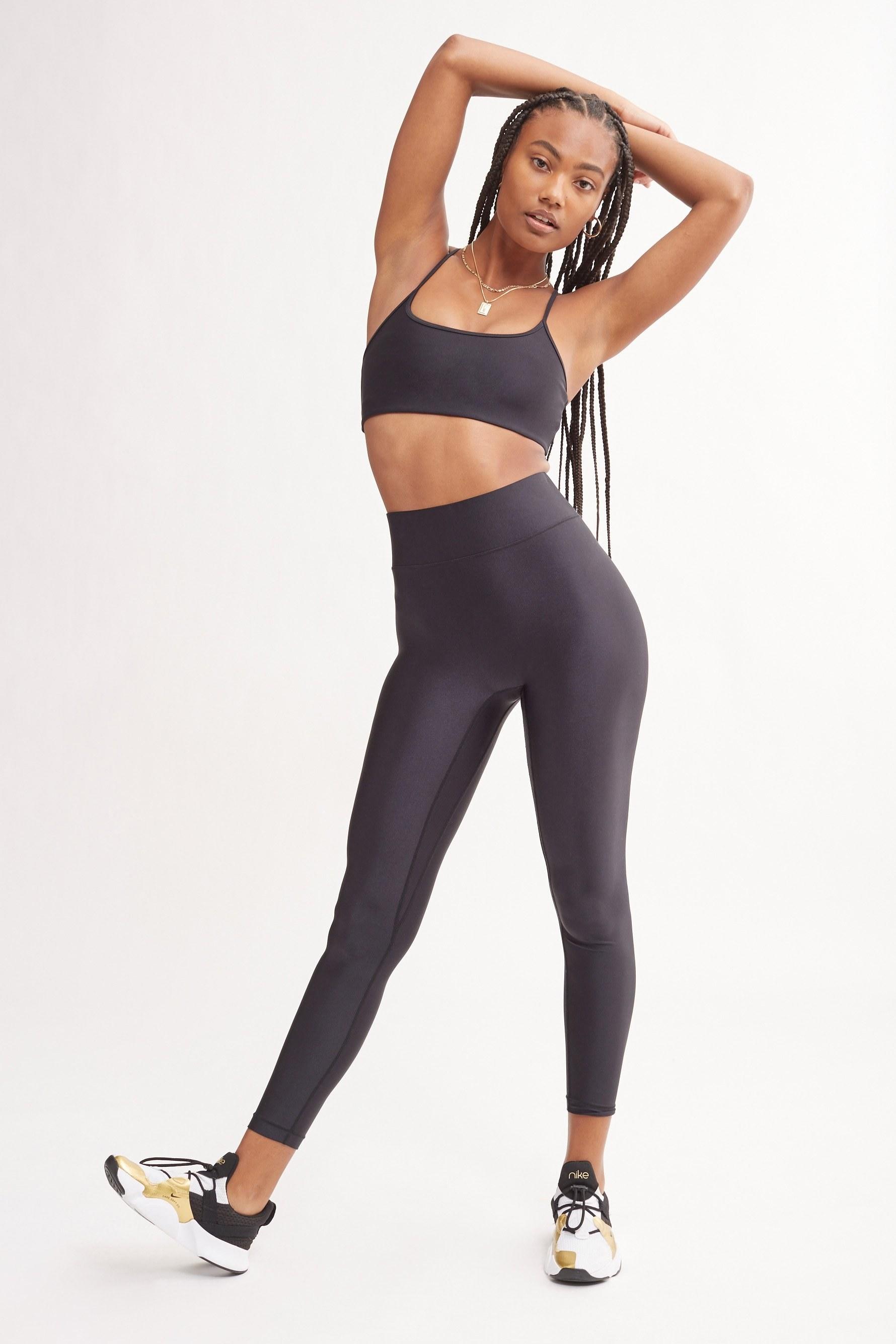 a model in black leggings
