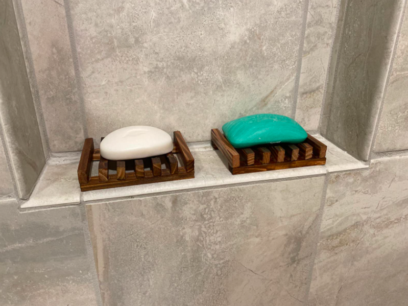 Reviewer's two wooden soap dishes with spaces to let soap drip